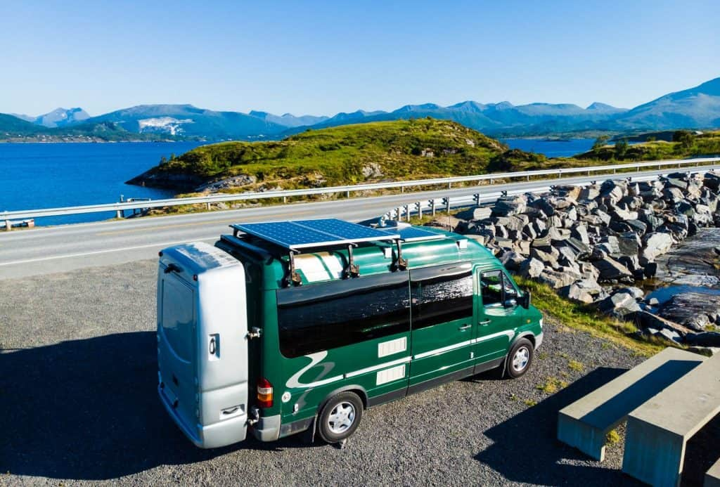 class c RV in norwegian fiords with solar panels - best solar kits hero image
