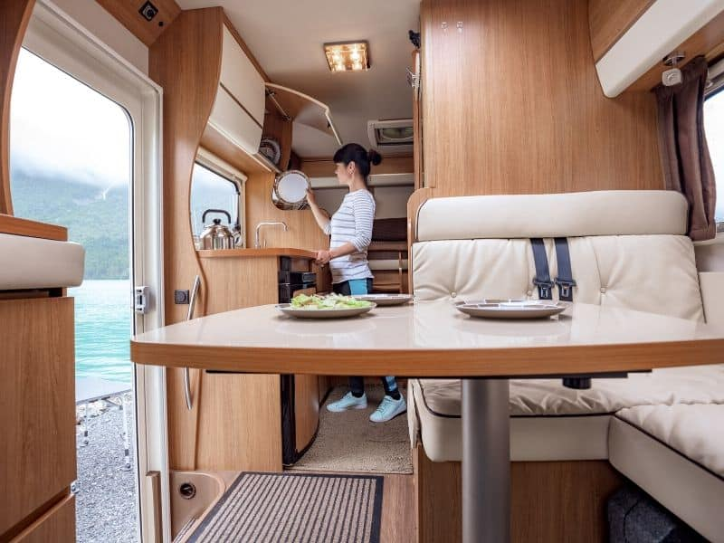 women-cooking-camper-interior-intext